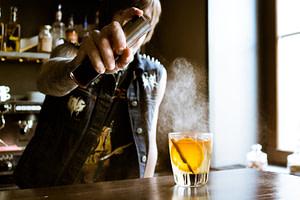 Bartender poring a sazerac